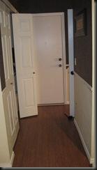 white quarter round installed on garage door