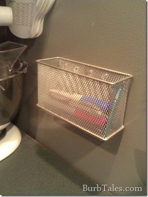 Cluttered magnetic pen basket